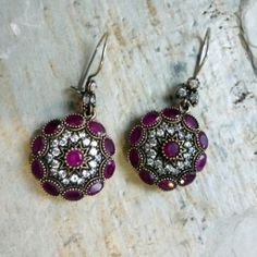 By Ottoman Jewels. ruby earrings made of oxidized sterling silver, adorned with tiny zircons. Each stone is wrapped in gold plating. Handmade in Turkey.