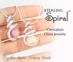 "This listing is for ONE Sterling Spiral™ pendant in Reflections™ with your sentimental item infused as a glass memory piece.  Spiral: A spiral of forty-five glittering stones, set in sterling silver, loop around like shiny, curled ribbons cradling a memory glass pearl in the bottom loop. It can be an elegant accompaniment to formal evening attire. The spiral setting is 1.25 x .75"" (32 mm x 17 mm). The glass is .375 (10 mm) and is the shape of a fat M&M.    Reflections™: The fine silvers m..."