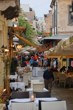 Shopping along the busy Plaka district streets in Athens, Greece.