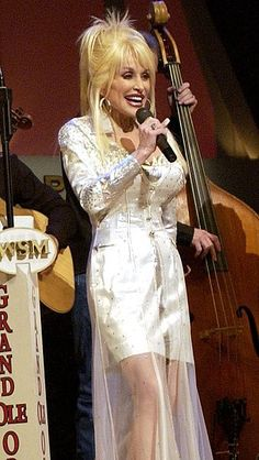 Dolly Parton @ the Grand Ole Opry https://play.google.com/store/music/artist?id=Aoxq3iz645k55co23w4khahhmxyfeature=search_result