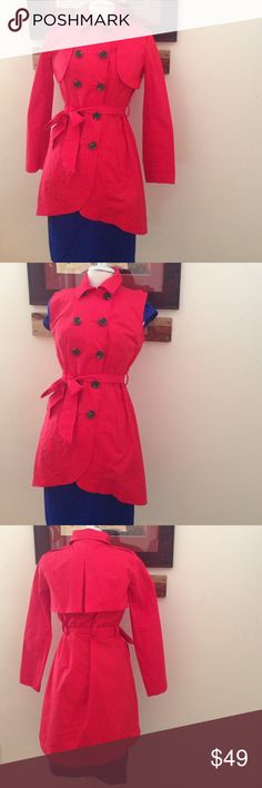 """Final price drop! CAbi Red Lightweight Coat CAbi, red coat, size 6. Style#334. RN#54077. Material: 98% cotton, 2% spandex. Measurements: shoulders: 16"""", bust: 19"""", length: 27"""" (in front), 36"""" (in back), sleeve length: 24"""". Features: double buttons, belt, collar, long sleeves, sleeves zip off for a sleeveless look, tiered hem short in front and longer in back. Pre-loved, minimal wear. All together in beautiful condition. CAbi Jackets & Coats"""