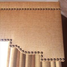 Linen covered cornice boards with nailhead trim.