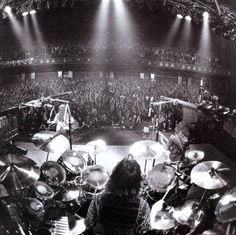 Neil Pert surrounded and enclosed in his heaven. best drummer in MY opinion. Who better to control the worlds largest drum set then its owner..