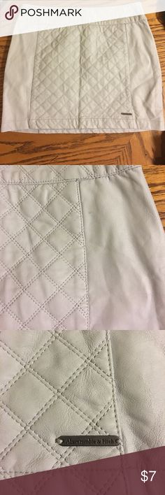 New Faux Leather Abercrombie and Fitch Skirt Light Gray color 13.5 inches from top to bottom. Never worn but has been in a bag full of clothes my daughter never wore. I took a pic of the issue, very small Abercrombie & Fitch Skirts Mini