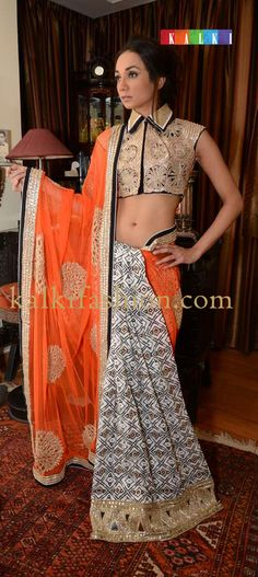 http://www.kalkifashion.com/ A model posing in half and half printed saree by Ira Dubey.