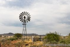 If you're looking for a value-for-money place to stay, Akkedisbult cottage near Hopetown in the Karoo could be just the ticket. Home Interior Design, Wind Turbine, Cottage, Exterior, House Design, Ticket, Places, Ideas, Casa De Campo