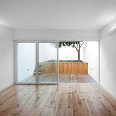 Lisbon apartment renovated by Portuguese architect Tiago Filipe Santos Lisbon Apartment, Interior Garden, Space Architecture, House Windows, Indoor Outdoor Living, Minimalist Living, Humble Abode, Beautiful Space, Interiores Design