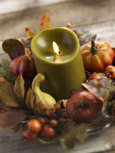 Quit dreaming of a cozy fall getaway.  Instead, create one at home!  Achieve a warm, colorful fall aesthetic in your space with these fall candle decorating ideas.  Includes fall