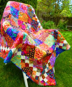 squares with white on-point squares border. Kaffe Fassett