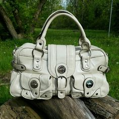 London Fog purse Good pre owned condition London fog patent purse. Its more like silver color. Shiny style. London Fog Bags Satchels
