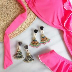 Beaded tassels feature a miniature seashell and druzy studs. Style with bright separates or crisp whites.