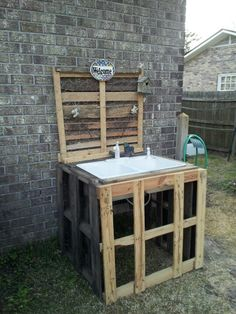 Its not done yet but its a start of my outdoor pallet garden sink.  Yep i done did it myself!!