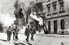 holocaust | SS officers walkingthrough the destroyed Ghetto after the Warsaw Ghetto ...