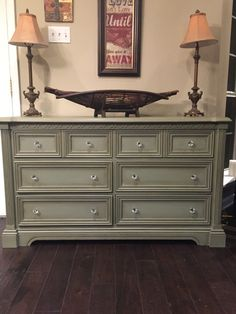 Painted in Annie Sloan Chateau Grey then clear & dark waxed. New knobs.