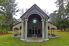"""Weymouth Family Chapel, Greenville, Delaware In Greenville, Delaware, artist and conservationist George """"Frolic"""" Weymouth erected an open-air stone chapel inspired by those the Du Pont descendant saw on English country estates. The 2006 structure is open to the elements and is accented with metal sconces and stained glass by artisan Robert P. Horan."""