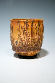 Stoneware cup with cattails and hummingbirds