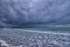 Storm clouds sliding in above the pier of Hook of Holland. Also notice the Arcus structure in the middle.