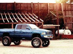 97 Blue Dodge Ram Truck lifted