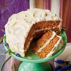 Layered Carrot Cake | The star of this classic carrot layer cake is the thick sweetened cream frosting that you spread between the cake layers and on the top and sides of the cake. The cake gets extra sweetness from the addition of crushed pineapple to the batter.