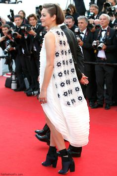 """Marion Cotillard in Dior Couture dress at the """"Deux Jours, Une Nuit"""" Premiere during the 67th Annual Cannes Film Festival."""
