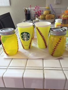 "Softball mason jars. I used Mod Podge in ""Sheer Yellow"" along with red glitter pen to create a cute project for my daughter.  Will turn one into a soap dispenser for her bathroom and the other will have goodies for her softball Big Sis."