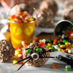 Kellogg's Cocoa Krispies Halloween Cats...Candy corn for ears, jelly beans & candy-coated chocolate pieces for eyes & nose, black string licorice for whiskers.