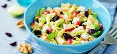 A shaved Brussels sprout salad made with dried cranberries, apple, walnuts, and pomegranate salad embraces the best fall produce items.