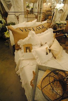 burlap pillow on a rusty bed ....love!