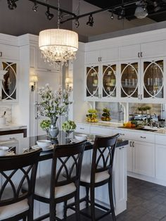 Love how the barstool seat backs mirror the cabinet design in this kitchen.