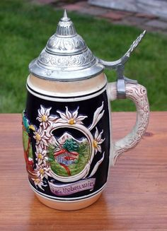 Up for sale is this beautiful made in German beer stein with pewter lid and colorful design. It features a pub design and the wording FROH BEIM BIER DAS LIEBEN WIR (which translates to GLAD FOR THE BEER WE LOVE). | eBay!