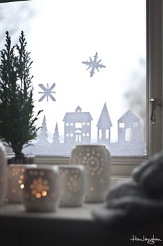 Town silhouette cut in paper. Nice background to the kids snowflakes.