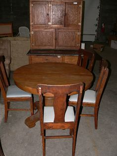 Super awesome antique Hoosier cabinet and oak table and chairs.