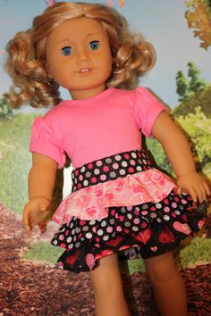 Any doll would feel pretty in pink in her new ruffled sparkly skirt and matching short gathered sleeve t-shirt. The skirt is made with three