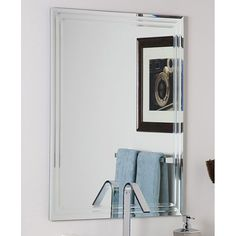 Add a new dimension to your space with this frameless wall mirror with a triple bevel detail along its edge. This mirror is ideal for any space in your home but is particularly suited for a bathroom environment, letting you style yourself with ease.