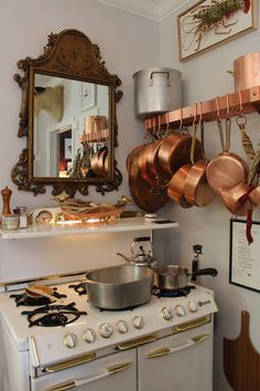 This maybe could inspire me to cook, I'd at least like being in the kitchen staring at these beautiful pots & pans
