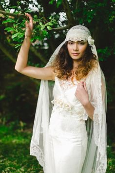 seventies inspired wedding gown with a Donna Crain veil.  http://www.weddingchicks.com/2013/12/09/dana-bolton-wedding-gowns/