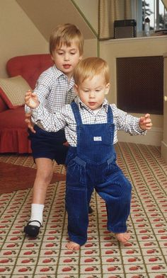William helping Harry as he is learning to walk... Brotherly love :-)