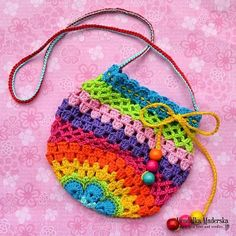 Crochet rainbow purse - free pattern.  Cute for the little girls!