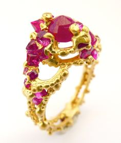 Polly Wales. Solomon Ring. 18ct yellow gold embedded with antique rubies Repin This by Joanna MaGrath