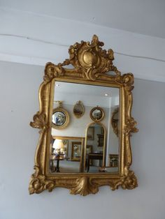 An antique carved wood gilt mirror.   wwww.annabellesgiltshop.co.uk