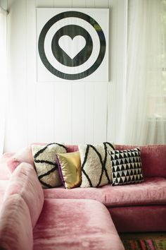 Style At Home: Jen Coleman Of Ascot + Hart on The Glitter Guide -- Love this comfy and pretty L-shaped pink velvet sofa topped with graphic black and white patterned Moroccan pillows, white paneled walls and a bold heart bullseye poster. Pink Velvet Sofa, Pink Couch, Interior Desing, Interior Inspiration, Room Interior, Modern Interior, Style At Home, Rosa Couch, Passion Deco