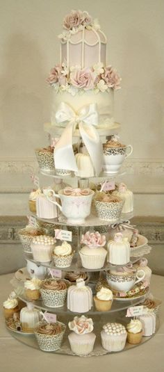 Beautiful wedding cake tower. I love all the little details- especially the cup cakes in tea cups!