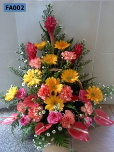 FA002: Triangle Arrangement of Carnations , Gerberas & Anthuriums