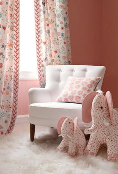pretty girls room nursery (that is, if you can stomach all this pink!) love the white chair, long curtains, and elephant accessories... would choose a different wall colour though