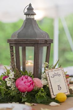 Pretty lanterns as centerpieces. View the full wedding here: http://thedailywedding.com/2016/06/23/festive-bohemian-wedding-inspiration/