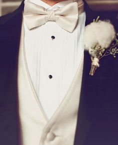 Southern cotton and seeded eucalyptus boutonniere Groom Tux, Groom And Groomsmen Attire, Bride Groom, Black Tuxedo Wedding, Vest And Bow Tie, Groom Shirts, White Bow Tie, White Shirt Men, White Wedding Dresses