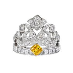 an Cleef & Arpels 'Ballet Precieux' Diamond Band Ring.  In 18k white gold, the band designed as a coronet with central modified-cut, 0.42 carat yellow diamond.