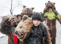 Children from Eastern Romania, dressed as a bear (bear - animal magic in culture Romanian people) come to the capital Bucharest, in their attempt to raise money from dancing bear. The tradition goes on! Photo by Fudulu Catalin — National Geographic Your Shot