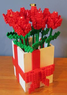 LEGO Flowers by TheBrickMan, via Flickr - Do you see the little LEGO bee? :)