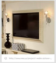 Flat screen TV framed in crown molding
